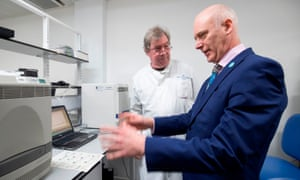 Scotland's public health minister Joe FitzPatrick meets technical section manager Graeme Gillespie during a visit to the coronavirus testing laboratory at Glasgow Royal Infirmary.