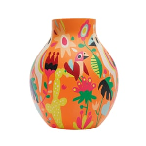 Curved vase with a wildlife print on orange terracotta background