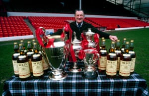 Liverpool's victory meant Bob Paisley became the first manager to win the European Cup three times. Here he shows off his haul from the 1980-81 season, alongside 16 bottles of Bell's whisky … his manager of the month and other special season awards