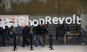 At an Apple store in France, activists painted the window to protest the company's tax evasion.