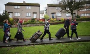 Syrian refugee families arrive at their new homes on the Isle of Bute, Scotland.