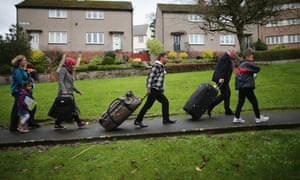 Syrian refugee families arrive at their new homes on the Isle of Bute, Scotland, last year.