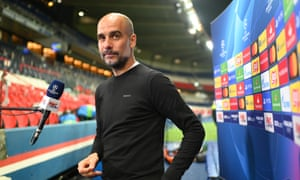 Pep Guardiola, Manager of Manchester City looks on during a TV Interview.