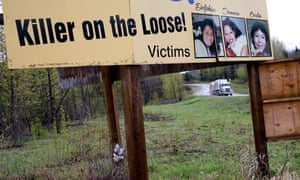 A truck drives past a road sign commemorating missing or killed Indigenous women on Canada's Route 16 in 2016 about 18 miles north of the town of Smithers, British Columbia.