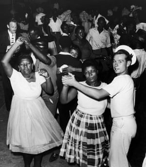 A British sailor joins Jamaicans at a dance in Kingston to celebrate after independence was granted to Jamaica, 6 August 1962.