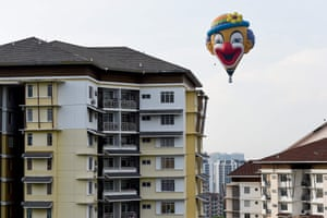 Putrajaya, Malaysia A hot air balloon flies over buildings in Putrajaya during the international hot air balloon festival