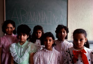 Girls at a Bible class in front of a blackboard