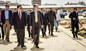Philip Hammond (centre) tours a naval base with Libya's prime minister designate Fayez al-Sarraj on a visit to Tripoli last week.