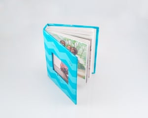 Aisha keeps all her visiting day photos in a small photo book