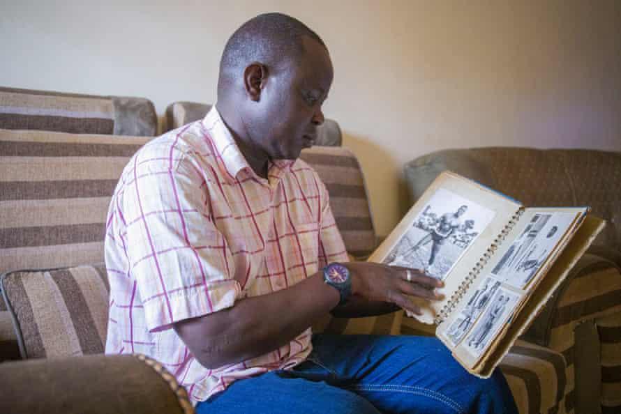 Samuel Okiror goes through his late father's photo album