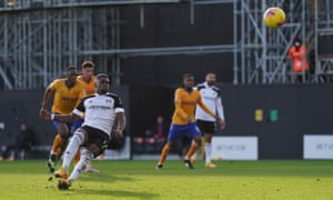 Ivan Cavaleiro slips as he skies his penalty for Fulham in the second half.