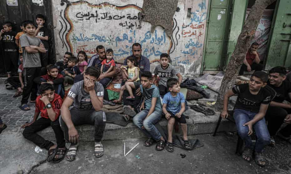 The children of the Palestinian al-Deyri family after their home was demolished by an airstrike in Gaza City.