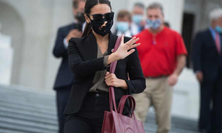 Alexandria Ocasio-Cortez carrying a Telfar bag