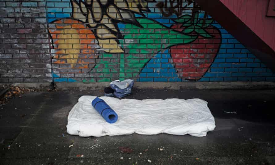 The bedding of a homeless person under a stairwell in Birmingham, England