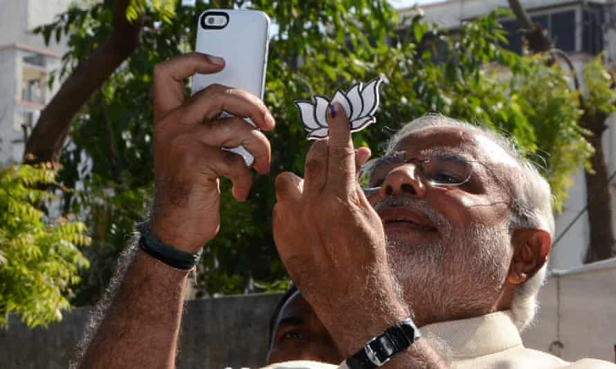 Indian prime minister, Narendra Modi, takes a selfie after casting his vote in 2014.