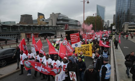 Demonstrators including Uber drivers, couriers and other outsource and contract workers protest in London in October.