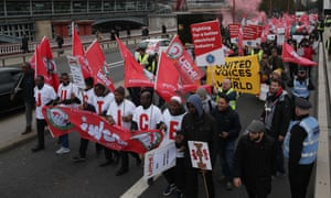 Demonstrators, including contract workers, march in London for better employment rights.