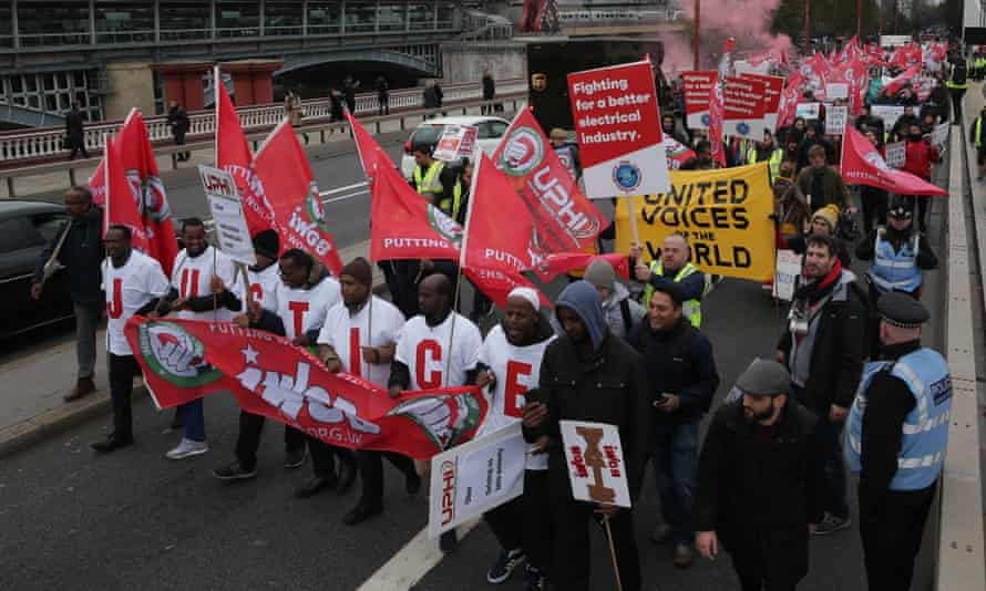 Demonstrators including Uber drivers, couriers and contract workers march for more employment rights in London last year.