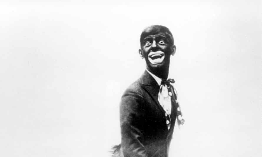 """Cantor<br>FILE - This 1920s image shows comedian Eddie Cantor wearing blackface while performing """"If You Knew Susie."""" Blackface minstrelsy is considered by some to be the first uniquely American form of entertainment. White men would darken their faces to create caricatures of black people, including large mouths, lips and eyes, woolly hair and coal-black skin. (AP Photo/File)"""