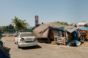 Abandoned cars dot the Community of Grace encampment near a Home Depot in Oakland, California.