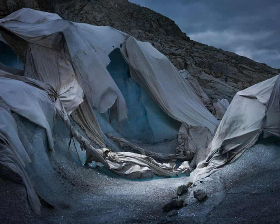 Shroud, 2018, by Simon Norfolk and Klaus Thyman:in an attempt to arrest the melting of the ice at an ice-grotto tourist attraction at the Rhône Glacier, local Swiss entrepreneurs paid for it to be covered up with a thermal blanket. 'We chose the title,' says Norfolk, 'because it looks like they have created a shroud for the glacier's death'