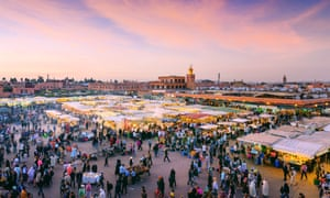 Marrakech's Djemaa El Fna Square in early evening light.