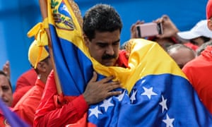 Venezuela's President Nicolas Maduro holds a national flag during the closing of the campaign to elect a constituent assembly.