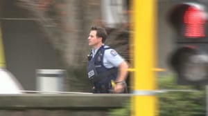 A video grab of a police officer rushing after reports that several shots had been fired at a mosque in central Christchurch