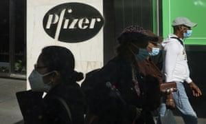 Pedestrians walk past the Pfizer world headquarters in New York City.