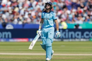A disappointed Buttler walks after being dismissed for 11.