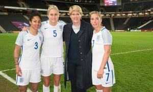 Clare Balding with members of the England women's football team in When Football Banned Women, Channel 4