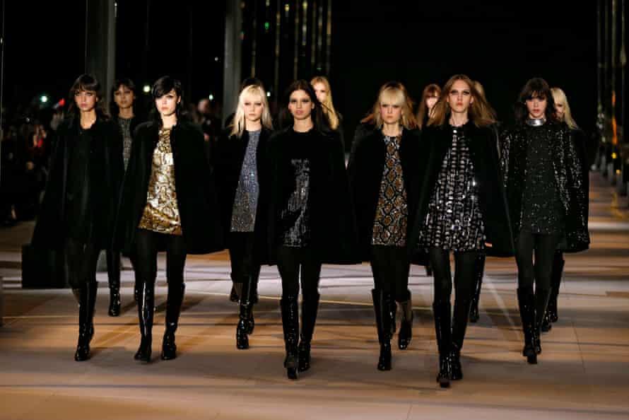Models on the autumn/winter 2014-2015 Saint Laurent catwalk.