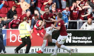 Andy Williams of Northampton Town turns to celebrate with team mate Sam Hoskins after scoring his sides second goal.