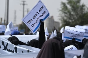 Kabul: Veiled women hold banners and placards while marching during a pro-Taliban rally outside the Shaheed Rabbani Education University