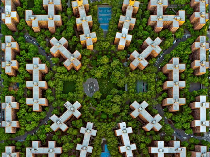 Fascinating sky-high look at the ordered cluster of brown buildings of Stuyvesant Town, a residential development in New York City.