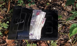 Wallet on ground full of £20 notes