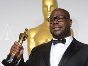 McQueen poses with his trophy after winning best picture award for 12 Years a Slave