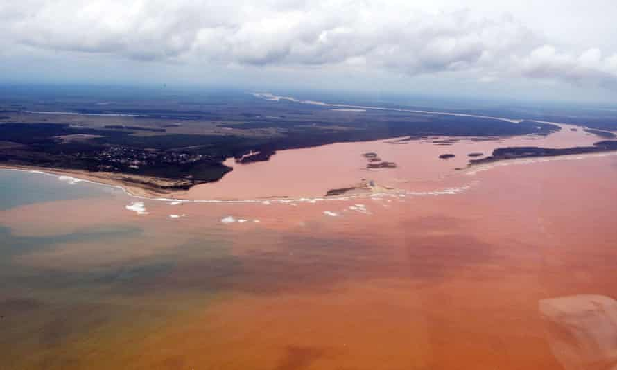An aerial view of the Doce River, which was flooded with toxic mud after a dam owned by Brazilian Vale SA and Australian BHP Billiton Ltd burst early this month, flowing into the Atlantic Ocean.