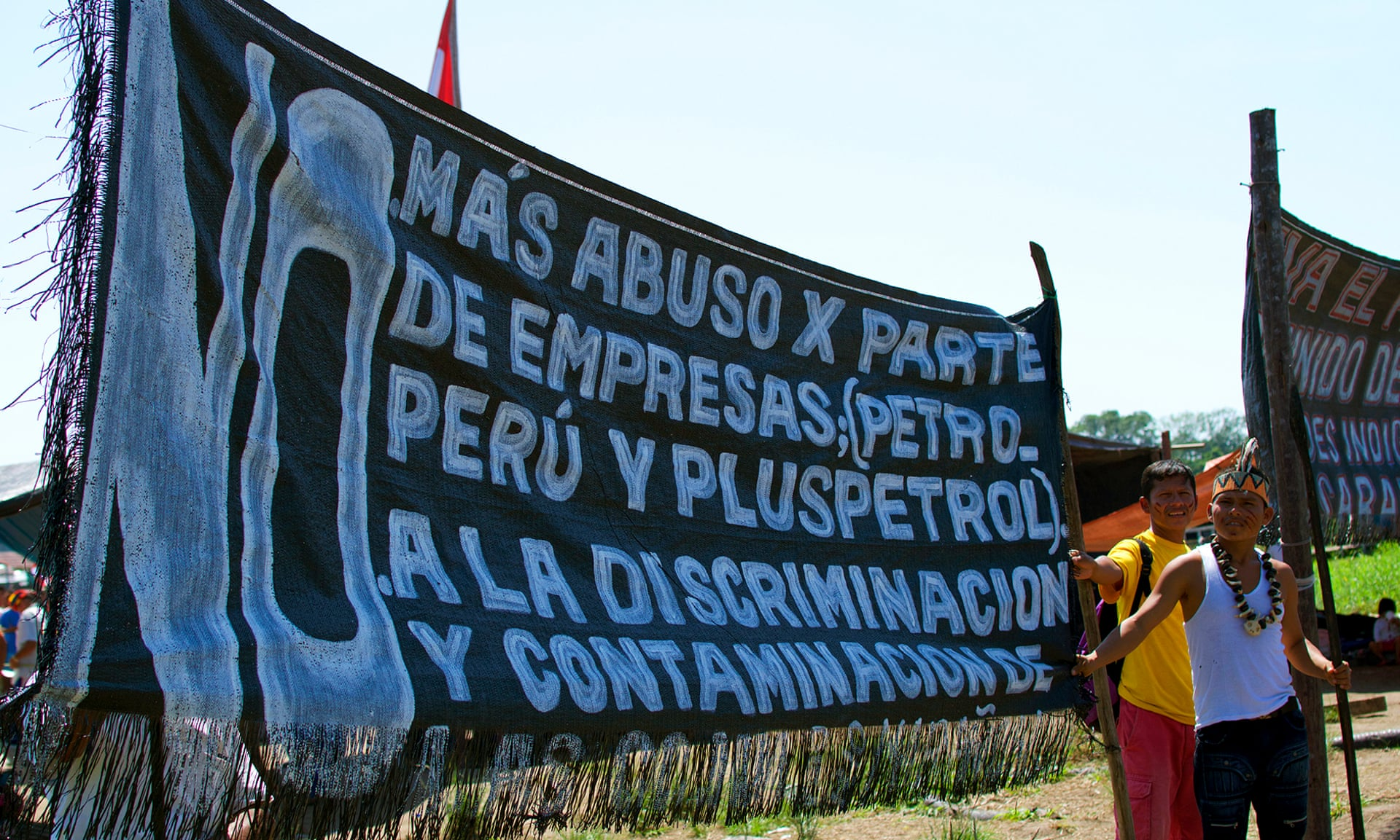 Banner denouncing Pluspetrol in the Saramurillo indigenous community in October 2016. Photograph: Sophie Pinchetti/The Chaikuni Institute