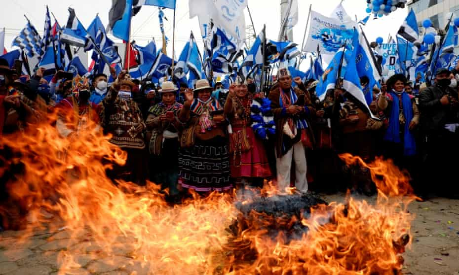 Witchdoctors take part in an offering to the Pachamama (mother earth) during a closing campaign rally of the Movement to Socialism party (MAS) ahead of the Bolivian presidential election, in El Alto, on Wednesday.