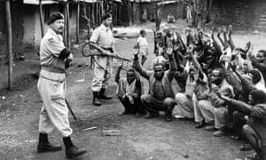 Members of the Devon Regiment help police search homes in Karoibangi during the Mau Mau uprising in Kenya.