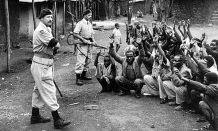 British soldiers assist police searching for Mau Mau members, Karoibangi, Kenya, 1954