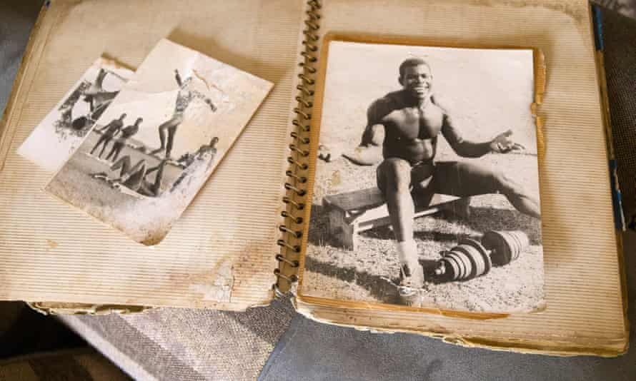 An album with photos of 'Sunlight' Okiror