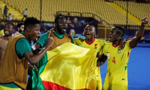 Benin players celebrate after their dramatic victory on penalties in Cairo.