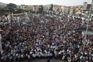 Arab Israelis take part in a large demonstration as part of a general strike organised to support Palestinians.
