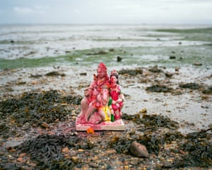 Shoeburyness, 5.30pm. An idol of Ganesh, the Hindu elephant god, is left on the Thames shore