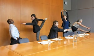 Workers stretching in conference room