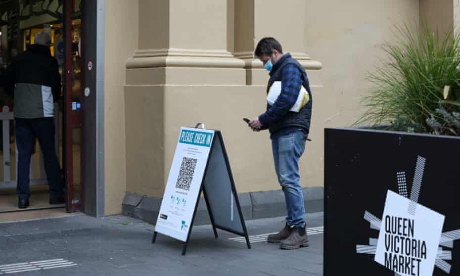A man scans a QR code at the entrance of Queen Victoria Market in Melbourne in August. The state government has launched an update to the Service Victoria QR code check-in app, which allows users to share their Covid vaccination certificate.