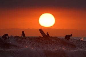 Newport Beach: Surfers prior to the scheduled closure of the beach because of the coronavirus outbreak