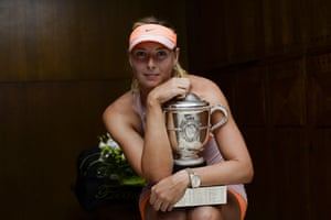 Maria Sharapova of Russia poses with the Coupe Suzanne Lenglen trophy in her changing room following her victory over Simona Halep in the 2014 French Open final